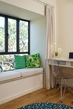 A white sitting window with green pillows in a boy's room. By Liat Hadas, Architecture & Design. #Livingroom #Design #Architecture #Table #Fabric #lifestyle #Colors #Mediterranean #View  #curtain #Styling #textile   #Bouquet #Windowbench #bench #Workspacedesign