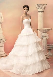 Style #1510L, strapless ball gown with tiered skirt, available in white and ivory