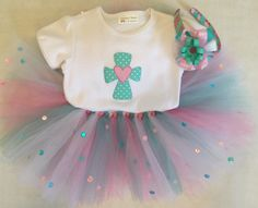 A personal favorite from my Etsy shop https://www.etsy.com/listing/267245157/sweet-cross-tutu-set-with-headband