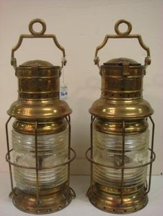 """Lot #566 (16th Nov, 14) - Live Auctioneers Pair of WILCOX, CRITTENDEN & CO INC, Marine Oil Lamps: Brass HURRICANE TESTED MARINE LAMPS with Fernel Lens. 19 1/2"""" Tall, 7 1/2""""Diameter, with BANGER Oil Lamps, Very Good Condition, Likely 19th Century. (300-500)"""