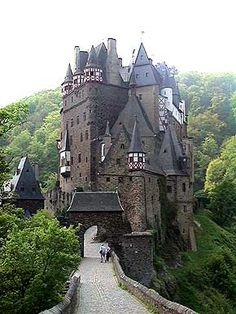 Burg Eltz Castle, Koblenz, Germany Burg Eltz is a medieval castle nestled in the hills above the Moselle River between Koblenz and Trier, Germany. It is still owned by a branch of the same family that lived there in century, 33 generations ago. Places Around The World, Oh The Places You'll Go, Places To Travel, Places To Visit, Around The Worlds, Beautiful Castles, Beautiful Buildings, Beautiful Places, Beautiful Beautiful