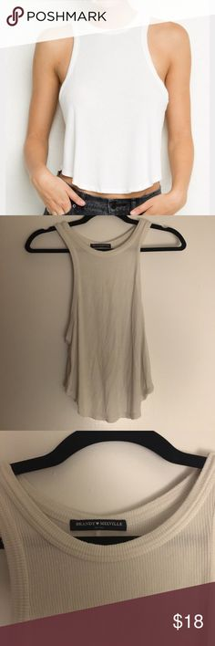 Brandy Melville White Tank Adorable Racerback tank from Brandy, in great condition! Fits a small-medium Brandy Melville Tops Tank Tops