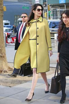 Human rights lawyer Amal Clooney looked ready for Spring in a fresh yellow Bottega Veneta ensemble while out in New York City.