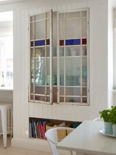 Petitevanou - vintage stain glass window as kitchen cabinet door.