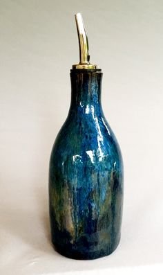 By Linda Neubauer  Midnight Blue x 2, Ancient Jasper x 2, Indigo Float x 2 on top half of bottle