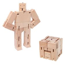 Robot toys are usually made of plastic and require batteries - but not this one! Inspired by the Japanese Shinto Kumi-ki puzzles, the Cubebot is a non-traditional take on the toy robot.