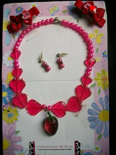 Strawberry Shortcake includes Necklace, two bows and earrings. All of my jewelry and accessories are handmade. At UniKreationz By Rose I believe that children's jewelry and accessories should complete your little diva's outfit and at the same time be very unique, adorable and eye catching! I can customize different colors to your specification if you don't see what your looking for. Just email me! I am always up for suggestions