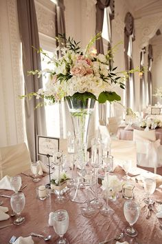 Pretty pink and white floral arrangement centerpieces.   Photo by Tara Lokey Photography. www.wedsociety.com  #wedding #centerpieces