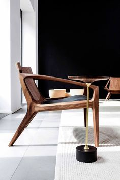 Wooden chair by Jader Almeida. Sculptural seems like the chair itself is lounging.