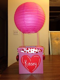 Hot air balloon Valentines Day box. Heart ornaments on sides for sandbags, hole cut in top for cards to go in.