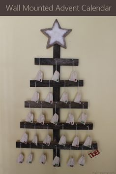 Wall Mounted Advent Calendar. There's a tutorial for you to follow so that you can make one for your family!