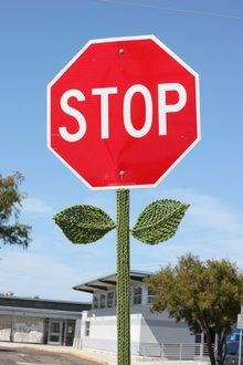 Yarn bombed stop sign - I think all of the stop signs should look like this!