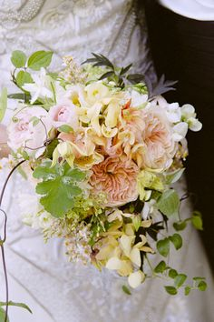 Loosely Shaped Bouquet of Garden Roses. Just right: a loosely shaped bouquet of lush, voluptuous blooms in soft, feminine hues plucked straight from True Blood's glowy peach, pink, and green fairyland palette. Garden Rose Bouquet, Rose Wedding Bouquet, Floral Wedding, Wedding Flowers, Yellow Wedding, Bride Bouquets, Floral Bouquets, Bouquet Flowers, Cascade Bouquet
