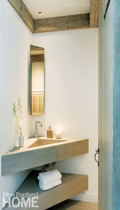 The compact powder room off the dining room features a custom triangular sink crafted from limestone.