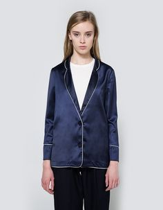 Sleepwear-inspired blazer from Farrow in Navy. V-neckline with rounded lapel. Dual button cosure. Straight back yoke. White piping at trim. Straight hem.   • Satin • 97% polyester, 3% spandex • Dry clean