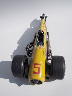 Scale model race car. Titled: Sonic Yellow. Pinned by #relicmodels