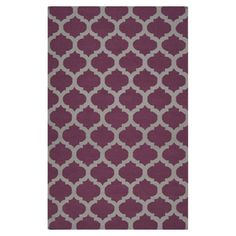 Anchor your living room seating group or define space in the den with this artfully hand-woven wool rug, featuring a quatrefoil trellis motif for eye-catchin...