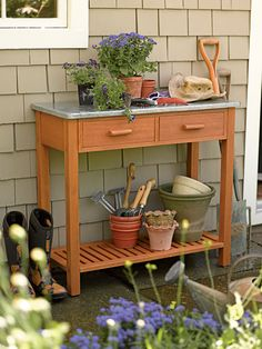 Potting Bench: Hardwood with Zinc Top | Buy from Gardener's Supply.  Sturdy, versatile table is ideal for seed-starting, potting up plants and more. Made from durable hardwood with an easy-to-clean zinc top; can be used indoors or out.