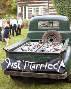 Country wedding bar, beer in back of old pickup truck.