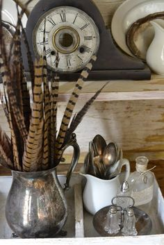 Pheasant Feathers in antique silver.  I already have the perfect old silver pitcher, that I got a great deal on, I will be buying some pheasant feathers soon! Thanks G for reposting this idea, so I can DO IT, lil sis...it will be on the piano in our dining room.....