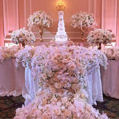 Flower galore! Perfect for romantic wedding reception this dessert table might be a great addition for your set-up. Major crush on the incorporation of lush flowers in white hue cascading the wedding cake table that spells a sweet yet elegant mood. Altogether with the multi-tiered floral arrangement on the background this will surely draw attention! What do you think? Yay or nay? Share your thoughts below!  Decoration by @avant_garden / Cake by @specialcakesbyruben / Venue at @taglyancomplex…