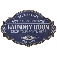 "Add a little vintage charm to your laundry room with this blue and white distressed metal sign with the words ""Open 24hrs Laundry Room Drop Your Pants Here."""