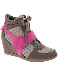 We're loving the sporty, style-savvy wedge sneaker this season! This streetwear essential amps up your look with a bright colorblock motif, giving you extra height on even the most casual of days. Tie-front closure with Velcro cross-strap. In comfortable wide widths with a non-slip sole.   Expert Style Tip: Wear them with a pencil skirt to give your office look some street cred, or keep the look edgy with our Weekend Jean. lanebryant.com