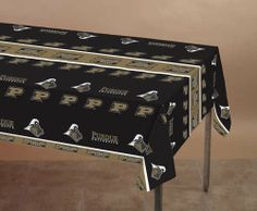 """Purdue Boilermakers Plastic Tablecover by Creative Converting. $4.21. From the Purdue University Party Supply Collection. Purdue Boilermakers Plastic Tablecover. Show your true colors with this tailgate party tablecover. Featuring authentic old gold and black team colors and Boilermaker team logo. Measures 108"""" x 54"""".. Save 42%!"""