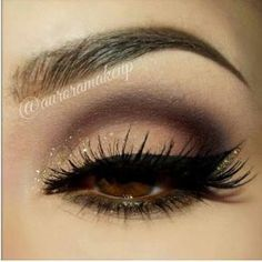 Smokey eye makeup, winged liner - cut crease eyeshadow in shades of brown with gold glitter. by estelle