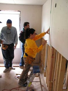 Volunteers putting dry wall up #aurora #oswego http://www.foxvalleyhabitat.org  Help Others and Volunteer Today!