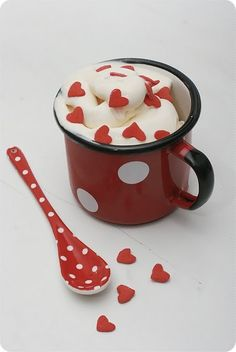 red heart sprinkles in hot cocoa with red polka dot mug and spoon - fun idea for cocoa packages