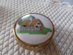 Brass trinket box, cross stitch lid, cottage picture, hand stitched, round trinket box, cream lining, three small feet, round pill box, by MaddisonsRainbow on Etsy