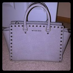 Rare Michael Kors Large Studded Selma in Grey PRICE DROP!! Worn only a handful of times, gorgeous Michael Kors Silver Studded Selma in Grey. 2, 3, 4 pics show true color. Comes from smoke free and pet free home. NO TRADES! Please ask all questions. Will come with long shoulder strap and dust bag Michael Kors Bags Satchels