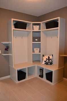 Corner Locker Design. I like the idea of using the corner for a tower of cubbies.  Less wasted space.