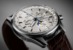 """Zenith Watches El Primero 410 Watch: Another Ode To The Past - by James Stacey - Read and see more on aBlogtoWatch.com """"Not willing to let the rather svelte grey Zenith El Primero 410 Limited Edition get that sweet movement all to itself, Zenith has launched another new 410 model which features a silver sun ray dial. \With a 42mm steel case and sapphire on both sides, the 410 forgoes the contrasting white-on-grey coloring and star markers at two and ten seen on the limited model..."""""""
