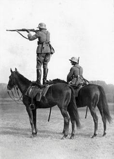 Display of mounted marksmanship by soldiers of the 100,000-man army allowed Germany after WWI, c. late 1920s.