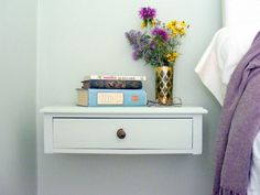 Instead of a bulky nightstand...DIY a floating bedside shelf or drawer. We love the simple and creative reuse of a bedside table into a space-saving floating shelf with drawer seen on D'Oh-I-Y. But you could re-purpose just about any type of shelf for this idea, even use a wall-mounted wooden box as a bedside cubby that will take up less floor space than a table.