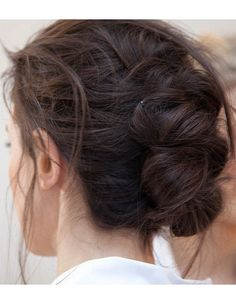 Romantic pinned-up braids, as on the runway at Michael Kors Spring 2014