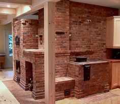 """""""Custom designed heater-cookstove combination, with Upper chamber bake oven, woodbox, heated bench and double width wall rising through all three floors of the house.""""  Probably WAY too much heater for Alabama winters... but, I do love a masonry stove so.  Click through and then click the """"Return"""" link for a fine wander through this gentleman's work."""