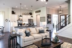 Regency Homebuilders : Great Room, Farmhouse Style, Scraped Hardwood, Open Concept Living, Granite, Recessed Lighting, Brick Fireplace, Shiplap, Fixer Upper (Cross Creek- Abbington Plan)