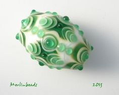 Oval Focalbead green on white dotpattern by Merlinbeads on Etsy, $32.00