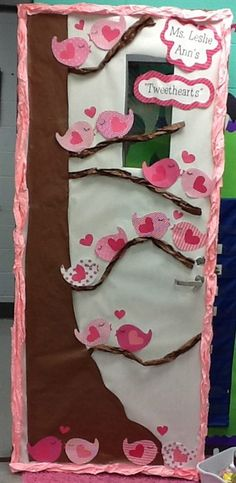 We love this Valentine's Day door from Leslie Ann over at Life in First Grade! The cutesy word play, adorable scrapbook bird cutouts, and festive color scheme work together to make a simple, yet...