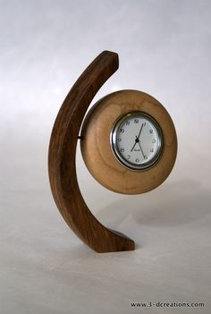 Balancing Walnut and Maple Clock by MadeWrightSF on Etsy, $33.95