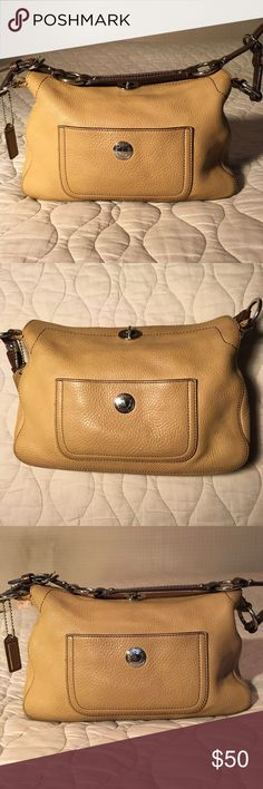 Authentic beige Coach bag Small Coach bag with brown strap and silver embellishments. Coach Bags Shoulder Bags