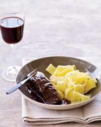 Easy Short Ribs Braised in Red Wine. Use corn or potato starch in place of the all-purpose flour. Serve with gluten free noodles or potatoes instead of the egg noodles.