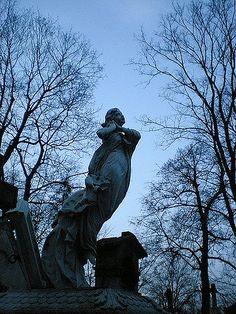 Powązki Cemetery in the twilight, Warsaw, Poland Cimitero Powązki al crepuscolo, Varsavia, Polonia Cmentarz Powazkowski, Warszawa, Polska by Irene Spadacini