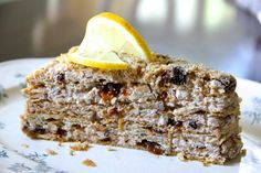 This many layered honey cake is made with soaked prunes and a bright lemon and wine filling. Press walnuts around the cake for the final, decadent crunch. Delicious Desserts, Dessert Recipes, Yummy Food, Prune Cake, Prune Recipes, Dough Cutter, Dough Ingredients, Walnut Cake, Honey Cake