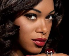 Dark girls can wear red lipstick too. This site shows what skin tones should use what color.