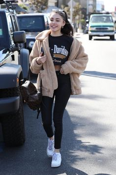 Madison Beer wearing I.am.gia Pixie Teddy Coat, Nike Air Force 1 Sneakers and Louis Vuitton Palm Springs Backpack
