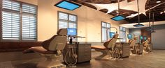 Dentist Office with TV's for Patients in Chair... but would be cool for infusion chairs too!